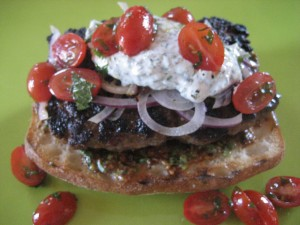 Lamb burger with yogurt cilantro dill sauce and mint tomatoes