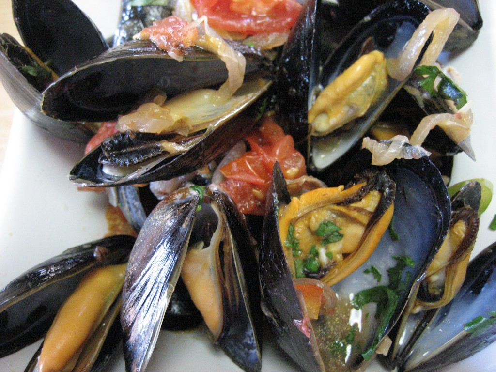 Thai inspired mussels with red chilies, lemongrass, garlic and tomatoes